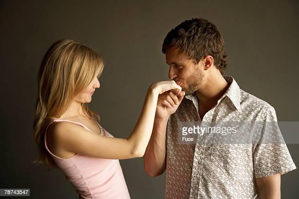Man Kissing a Womans Hand