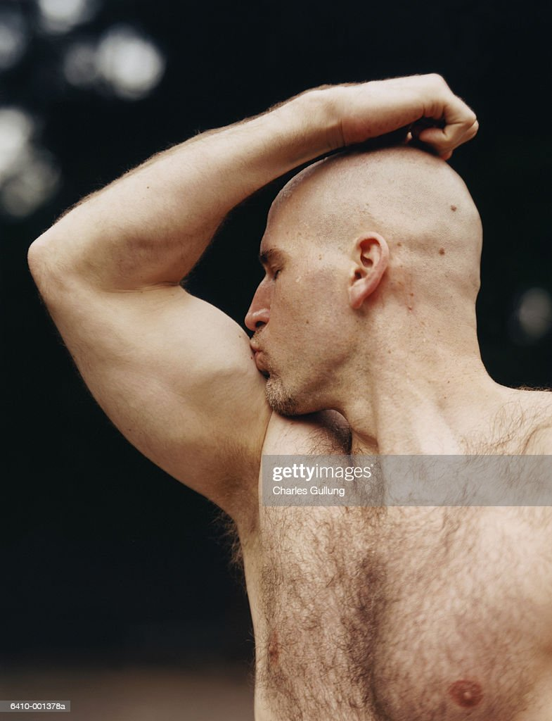 Man Kissing Biceps : Stock Photo