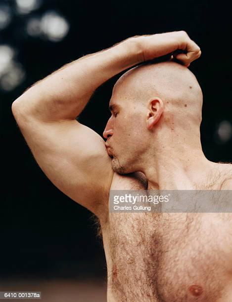 man kissing biceps - hairy chest stock photos and pictures