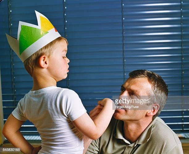 Man Kissing Boys Hand