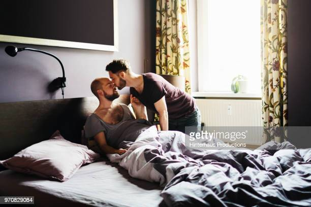 Man Kissing His Partner Before Leaving For Work
