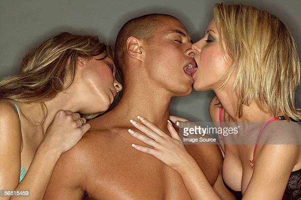 man kissing two women - naket bildbanksfoton och bilder