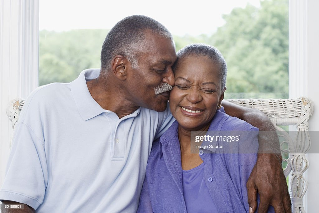 Man kissing wife : Stock Photo