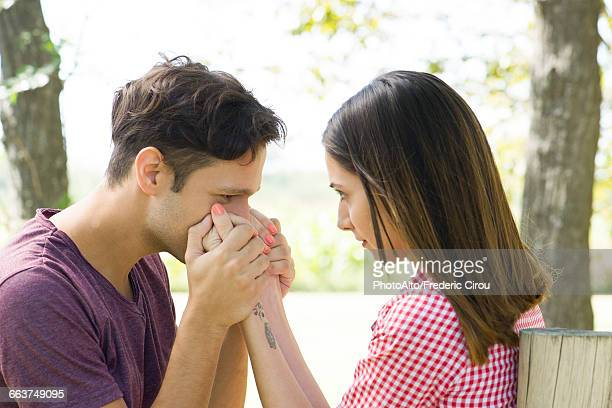 Man kissing wifes hand