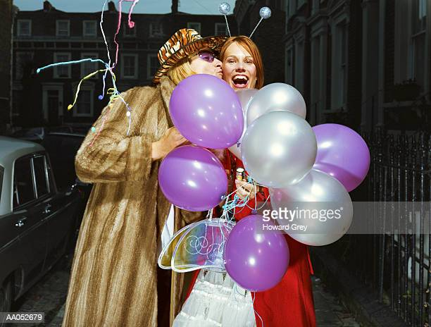 man kissing woman holding balloons - frock coat stock pictures, royalty-free photos & images