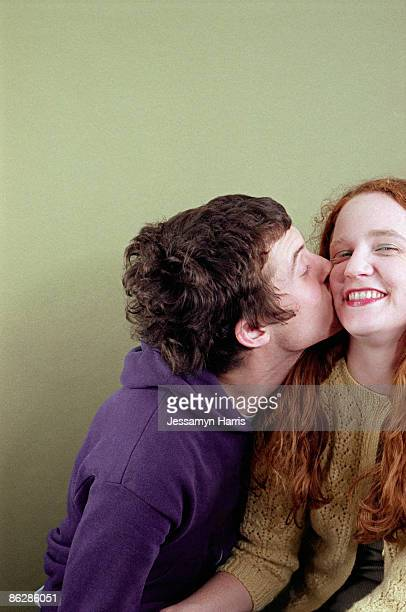 man kissing woman - jessamyn harris stock pictures, royalty-free photos & images