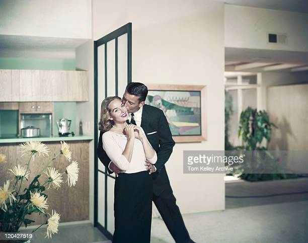 man kissing woman, smiling - archival stock pictures, royalty-free photos & images