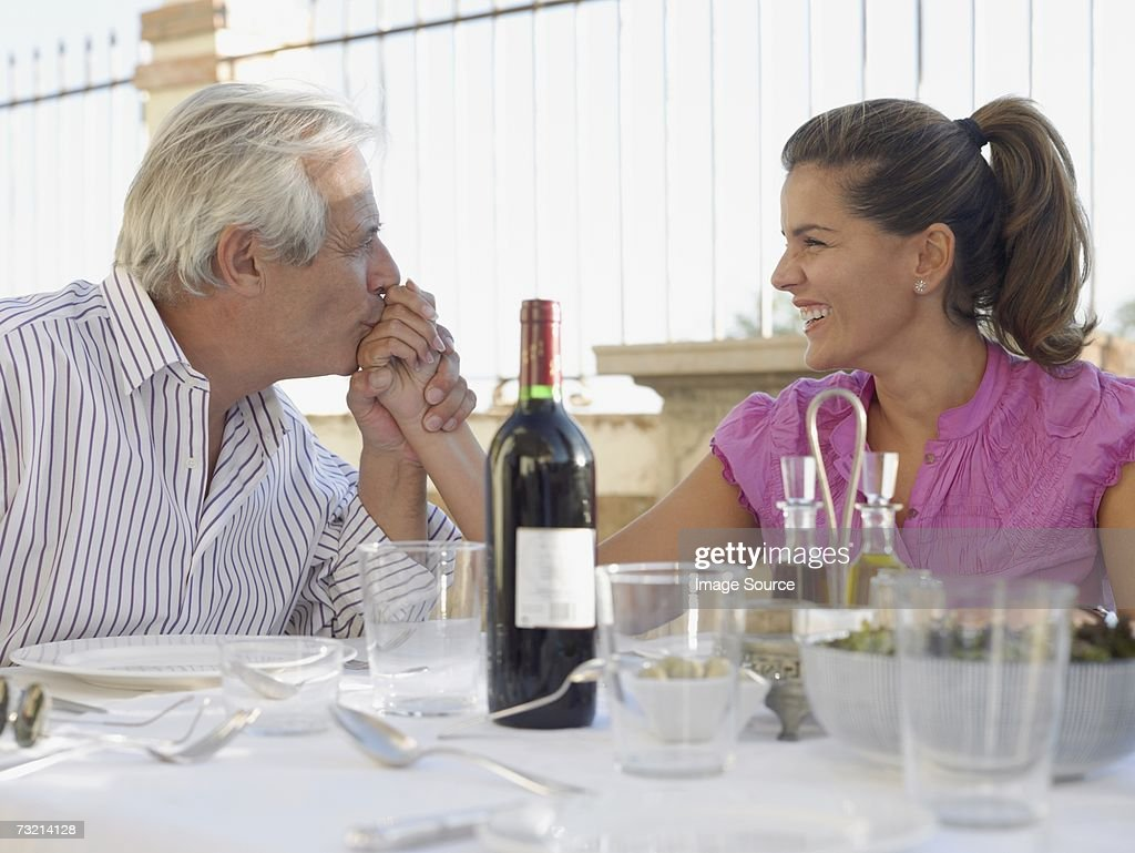 Man kissing woman's hand : Stock Photo