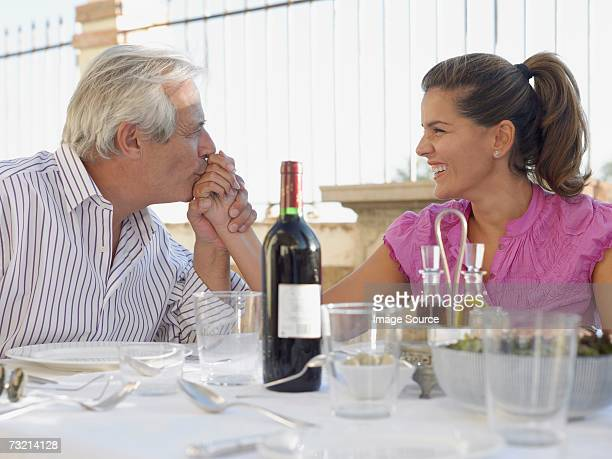 man kissing woman's hand - sugar daddy stock photos and pictures