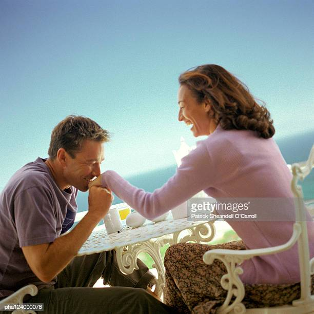 Man kissing woman's hand