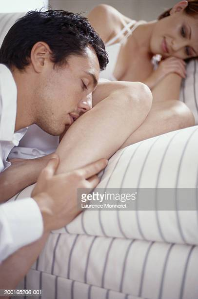 man kissing woman's leg, close-up - leg kissing stock photos and pictures