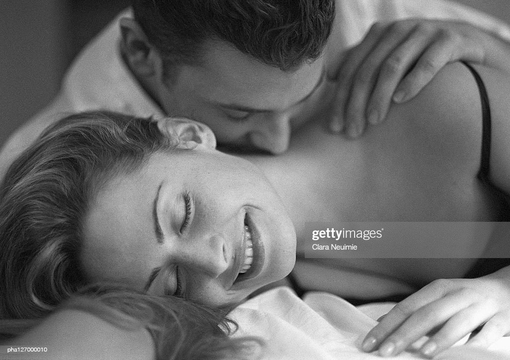 Man kissing woman's neck, close-up, b&w