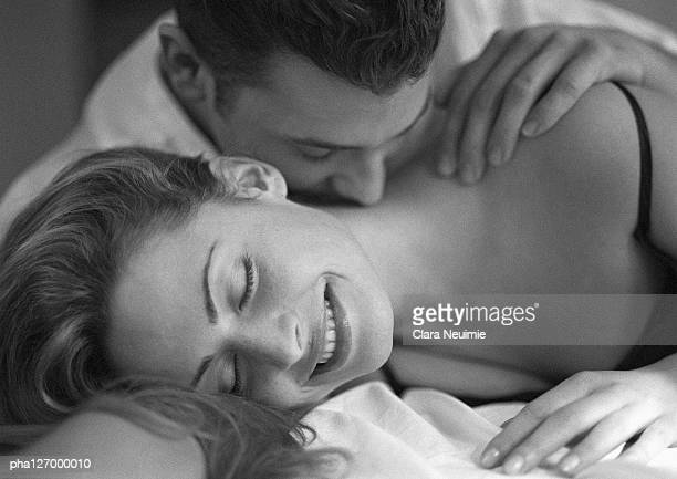 man kissing woman's neck, close-up, b&w - girlfriend stock pictures, royalty-free photos & images