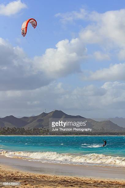 Man Kite Surfing in the Teal Waters of Kailua Beach with the Mokapu Peninsula in the Distance