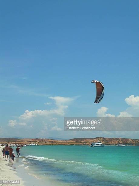 Man kite surfing on beach, Coche Island, Venezuela