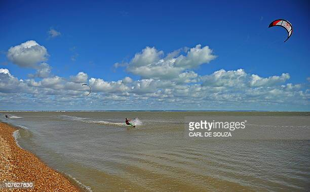 A man kite surfs along the sea in Dungeness Kent on August 24 2010 AFP PHOTO/Carl de Souza
