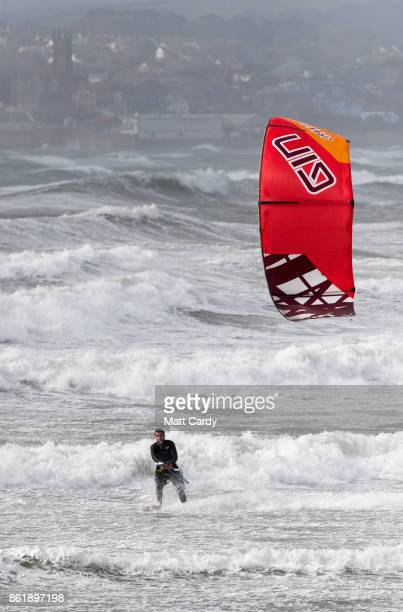 A man kite surfs in St Mount's Bay near Penzance as the effects of Hurricane Ophelia begin to be felt on the west coast of the United Kingdom on...