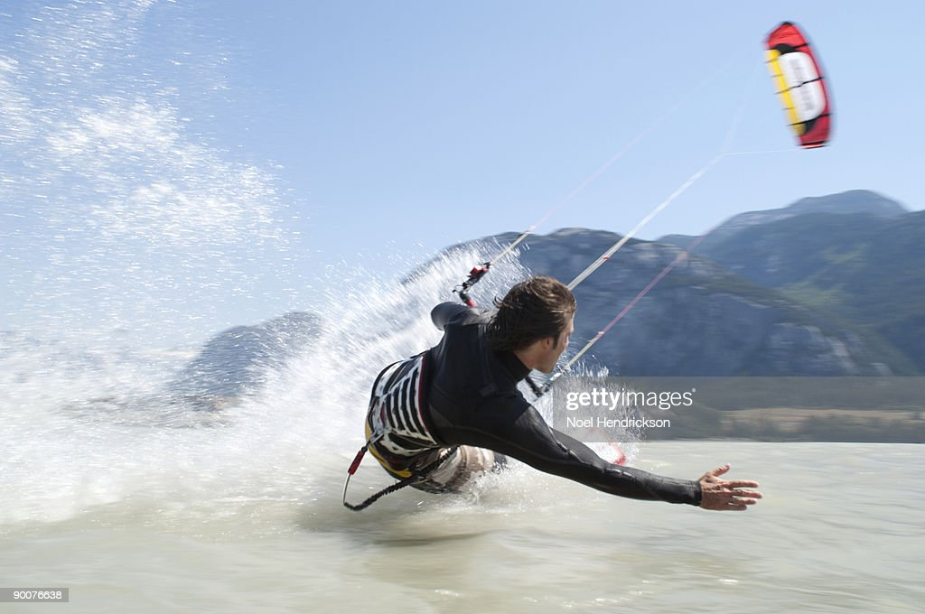 man kiteboarding, on water : Foto de stock