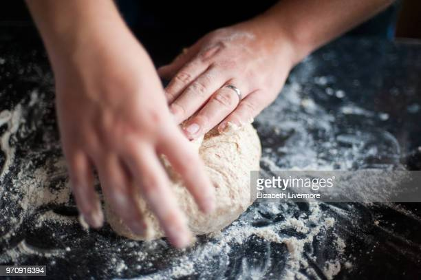 man kneading bread dough - baked pastry item stock pictures, royalty-free photos & images
