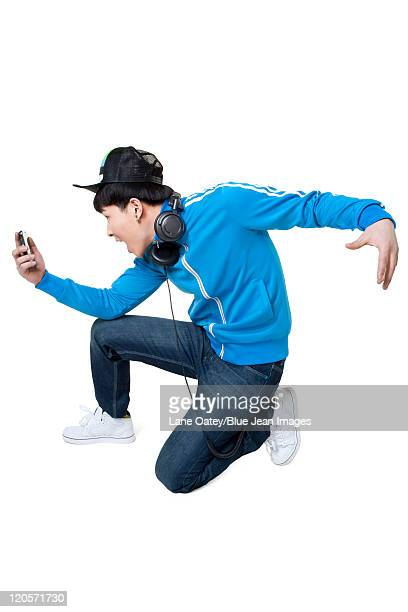 Man kneeling and looking at his phone