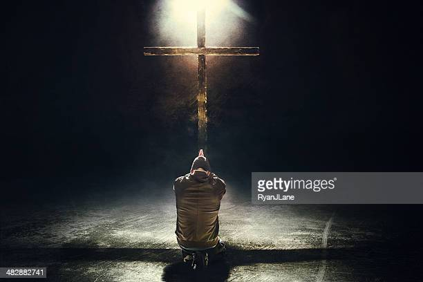 man kneeling before the cross - the crucifixion stock pictures, royalty-free photos & images
