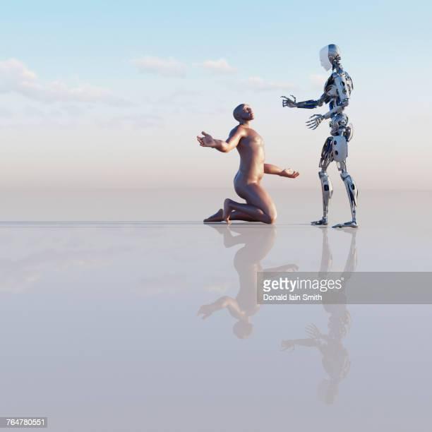 man kneeling near robot - homo erectus foto e immagini stock