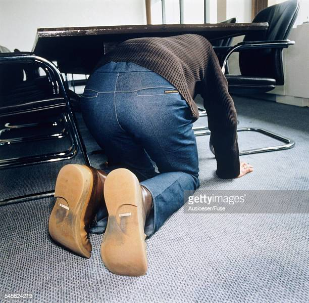 Man kneeling under a table