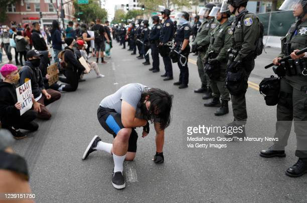 A man kneels during a protest for the killing of George Floyd outside of San Jose City Hall in downtown San Jose Calif on Sunday May 31 2020