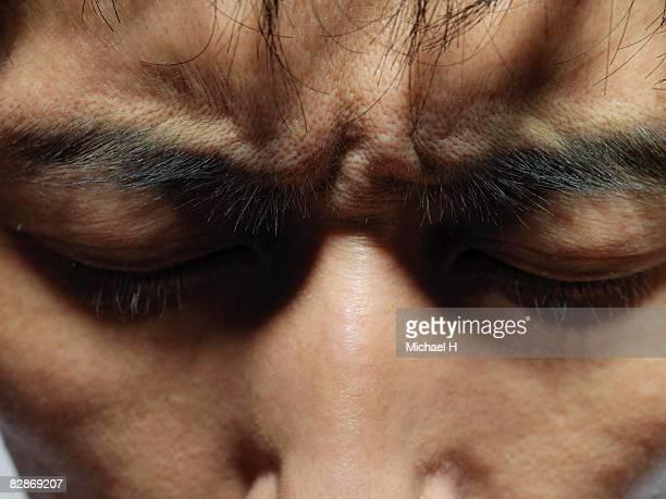 A man knits his brows,close-up