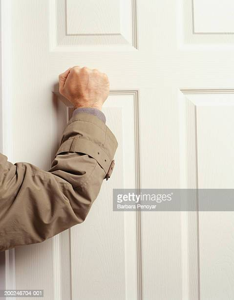 man knocking on door, (mid section) - knocking on door stock photos and pictures