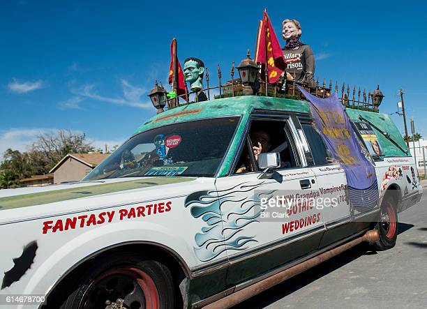 A man known as Grandpa Vampire drives his hearse adorned with a Hillary for Prison 2016 mannequin drives past the site of Vice President Joe Biden's...