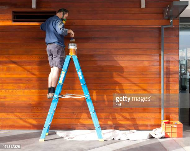 man lacquering wood - step ladder stock photos and pictures