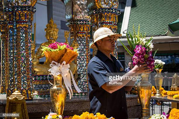 Man laid flowers at the reopened Erawan Shrine in Central Bangkok on August 19th 2015, after a bomb exploded outside this shrine on August 17th,...