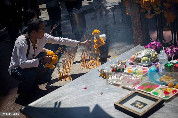 Man laid incense at the reopened Erawan Shrine in Central Bangkok on August 19th 2015, after a bomb exploded outside this shrine on August 17th,...