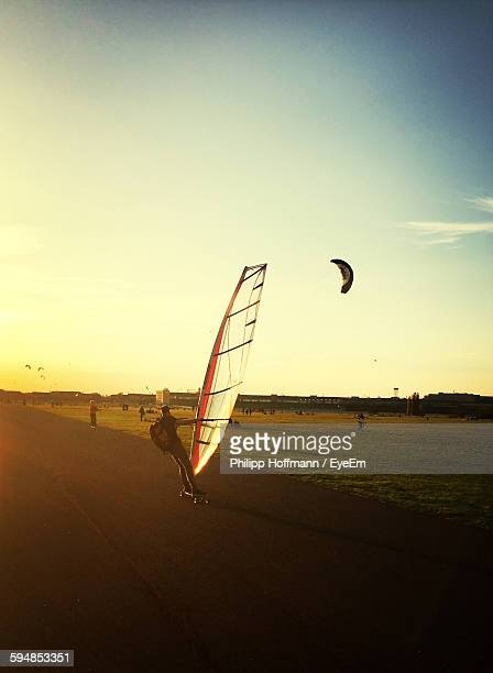 Man Land Sailing On Road Against Sky During Sunset