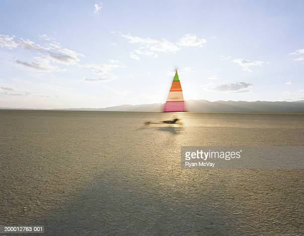 Man land yachting in desert, side view, Nevada, USA (blurred motion)