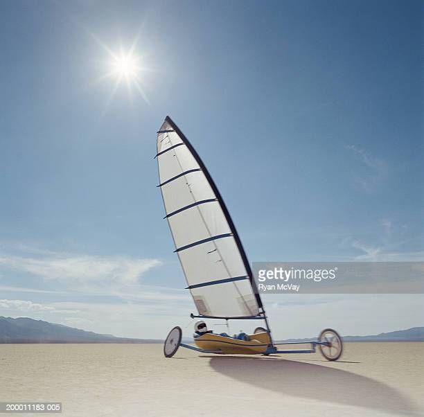 Man land yachting on dry lake bed, Smith Creek, Nevada, USA