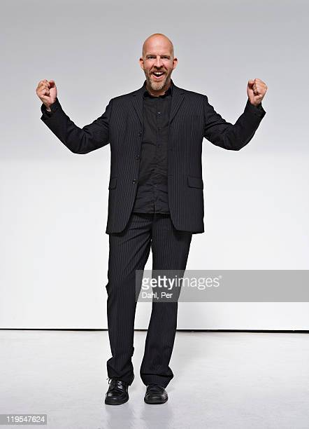 Man laughing against white background
