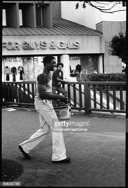 A man laughing as he clutches his ghetto blaster downtown San Francisco USA 1980