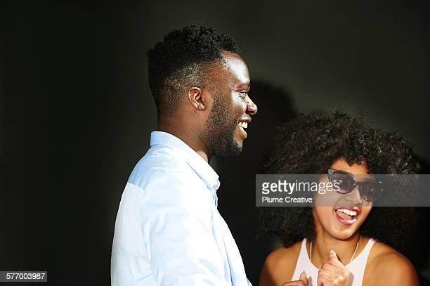 Man laughing at party.