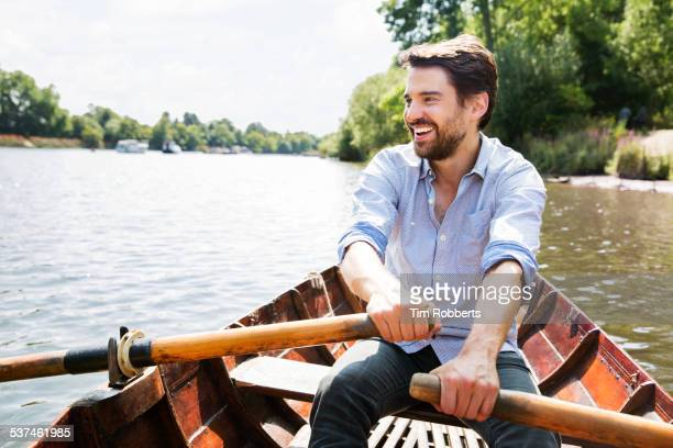 Man laughing in row boat