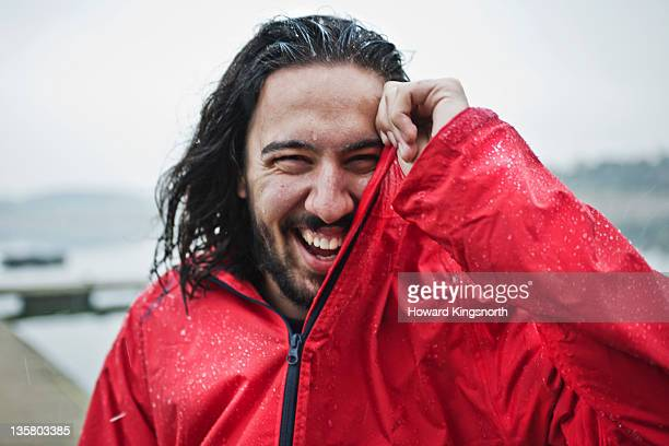 man laughing in the rain, portrait
