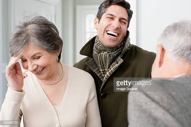 Man laughing with parents