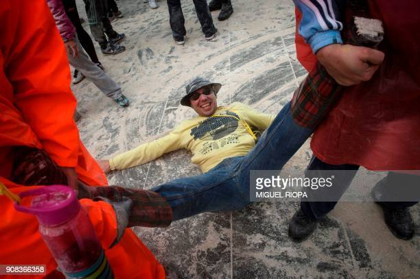A man laughs as he takes part in the 'Domingo Fareleiro' festival in the village of Xinzo de Limia northwestern Spain on January 21 2018 / AFP PHOTO...