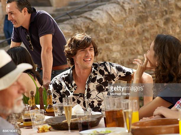 Man laughs at a party