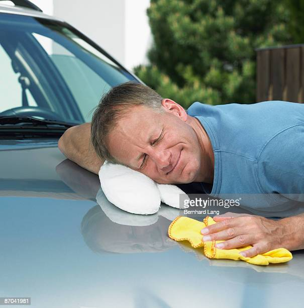 Man laying head on engine bonnet