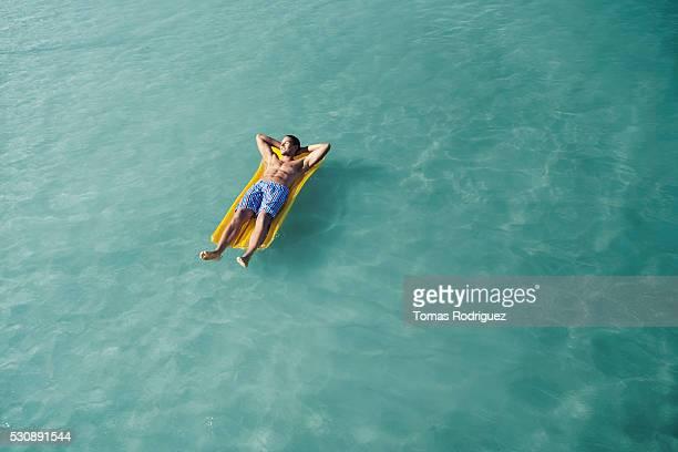 Man laying on raft