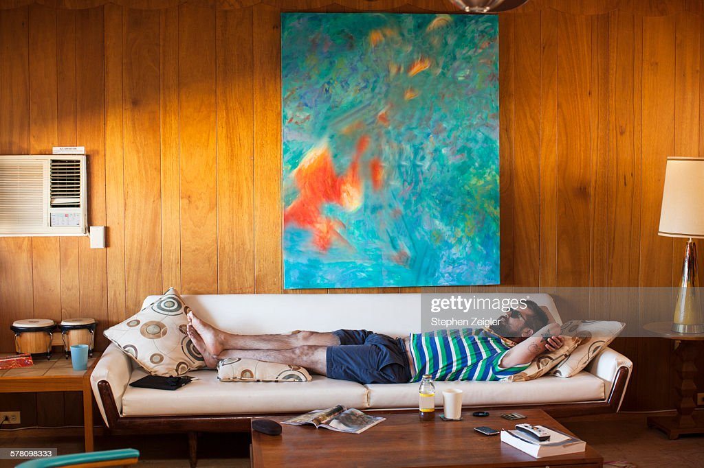Man laying on sofa : Stock Photo