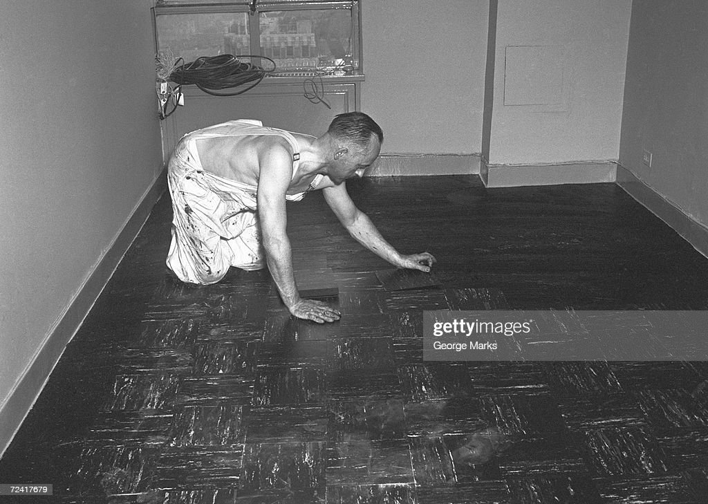 Man Laying Tiles On Floor Stock Photo Getty Images