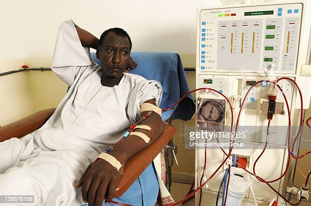 Man laying while attached to dialysis machine